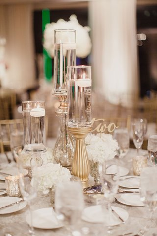 wedding-reception-table-low-arrangement-cluster-of-white-flowers-and-candles