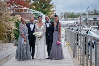 bride-in-berta-wedding-dress-bridesmaids-in-dusty-purple-bride-with-family