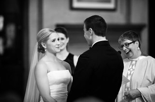 black-and-white-photo-of-bride-in-a-strapless-vera-wang-dress-veil-with-groom-in-a-black-tuxedo