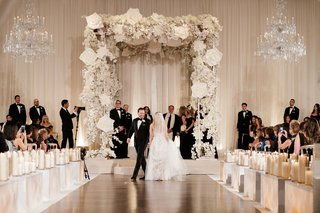 bride-and-groom-doing-seven-circles-tradition-jewish-wedding-chuppah-white-flowers-orchid-rose