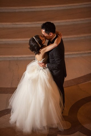 bride-in-a-strapless-kenneth-pool-dress-with-embroidered-bodice-tulle-skirt-groom-in-black-tux