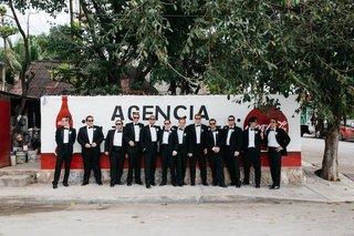 groom-and-groomsmen-in-black-tuxedos-in-playa-del-carmen-mexico