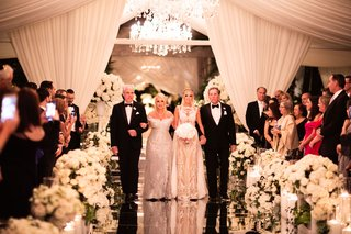 bride in adam zohar wedding dress walking down reflective mirror aisle jewish wedding with modern family