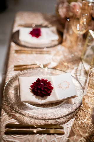 wedding reception gold linens luxe linen burgundy dahlia flower gold flatware amber glassware