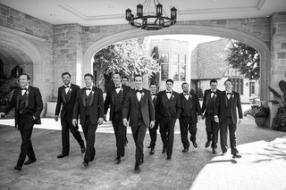 black-and-white-photo-of-groom-and-groomsmen-black-and-white-look-fancy-and-walk-together