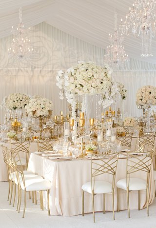 gold-chameleon-chairs-and-candelabra-at-white-reception