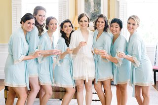 bride-bridesmaids-white-blue-robes-getting-ready-classic-southern-wedding-drinks-mimosas-morning-of