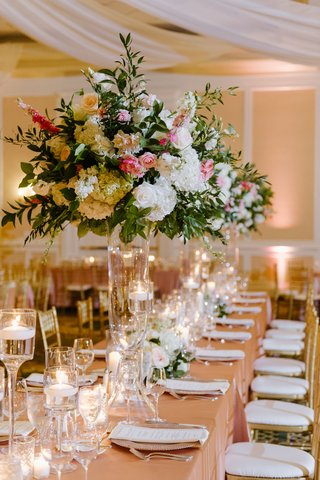 wedding-reception-long-rectangle-table-blush-linen-tall-centerpiece-white-pink-greenery-candless