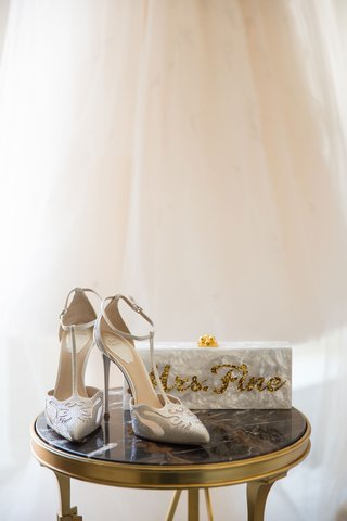 rene-caovilla-wedding-shoe-t-strap-pumps-with-mother-of-pearl-box-clutch-with-gold-sequin-lettering