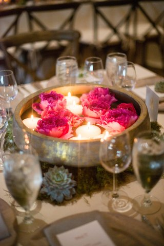 wooden-and-gold-bowl-with-floating-candles-and-bright-pink-peonies