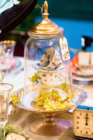alice-in-wonderland-wedding-shoot-stack-of-teacups-and-green-orchids-under-glass-dome