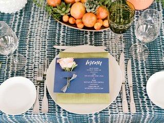 rooftop-bridal-shower-lime-green-napkin-blue-menu-card-pink-rose-bowl-of-succulents-and-fruit-green