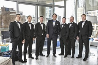 groom-with-tux-and-blue-bow-tie-with-groomsmen