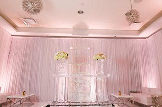 wedding-lounge-area-with-shelving-of-acrylic-and-flower-display