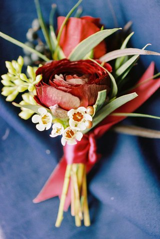 beauty-beast-movie-styled-wedding-shoot-red-green-boutonniere-grooms-accessories-roses-christmas