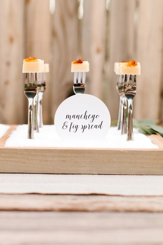 to-make-sure-wedding-guests-know-what-type-of-cheese-theyre-eating-display-signage-in-front-of-eac