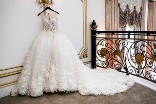 shannon-perkins-whitehead-wedding-dress-randy-fenoli-from-kleinfeld-bridal-hanging-up-legacy-castle