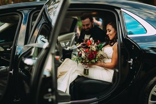 stephanie-perez-and-brandon-hampton-in-transportation-car-getaway-on-way-to-reception-space-hotel