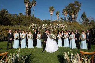 echosmith-singer-sydney-sierota-and-cameron-quiseng-wedding-ceremony-outdoor-bridesmaids-groomsmen