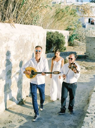 mykonos-greece-destination-wedding-ceremony-processional-bouzoukia-musicians-walking-bride-to-church