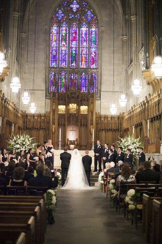 bride-and-groom-at-altar-of-duke-university-chapel