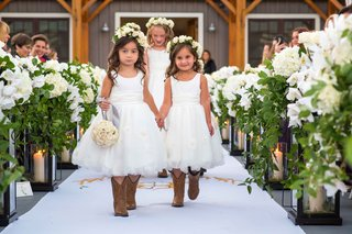 flower-girls-holding-hands-walking-down-aisle-flower-crown-cowboy-boots-pomander-ball-of-flowers