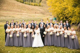 bridesmaids-in-purple-gray-watters-two-piece-gowns-and-fur-wraps-bride-in-isabelle-armstrong-fall
