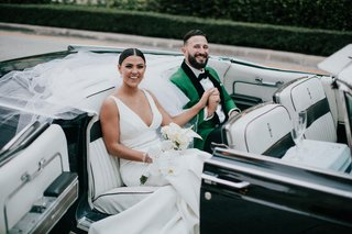 wedding-car-getaway-ceremony-to-reception-transportation-groom-in-green-tuxedo-jacket-champagne