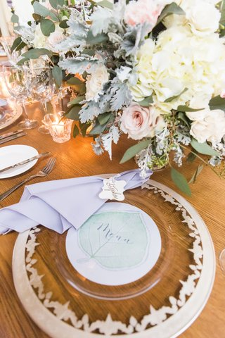 unique-gold-rimmed-charger-menu-with-sheer-leaf-illustration-lavender-napkin