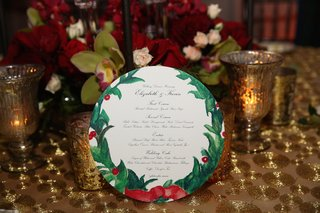wedding-menu-on-circle-paper-with-holly-christmas-motif-design