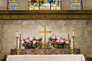 pink-flowers-in-gold-bowls-on-christian-altar