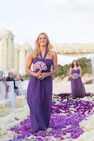 bridesmaid-walking-down-beach-flower-petal-aisle