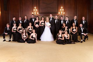 bride-and-groom-with-bridesmaids-and-groomsmen-in-black-dresses-and-suits