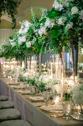 wedding-reception-head-table-with-tall-arrangements-of-ivy-and-other-greenery
