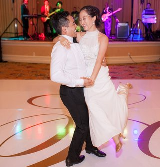 wedding-reception-gold-monogram-dance-floor-live-band-purple-lighting-first-dance-choreographed-spin