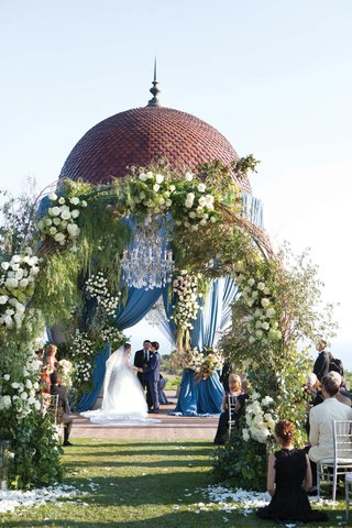 resort-at-pelican-hill-wedding-with-blue-drapery-on-rotunda-arches-of-floral-and-greenery
