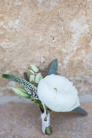 grooms-boutonniere-white-flower-buds-and-greenery-white-ribbon