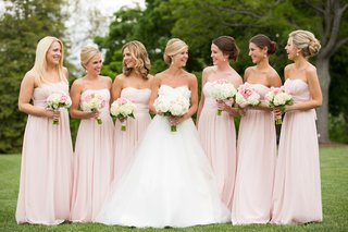 bride-with-bridesmaids-in-strapless-floor-length-gowns
