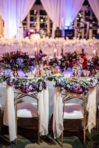 wedding-reception-ballroom-chameleon-chair-collection-gold-bride-groom-chairs-drapery-greenery
