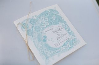 ceremony-program-with-blue-intricate-design
