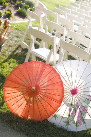 orange-and-white-paper-parasols-for-wedding-guests
