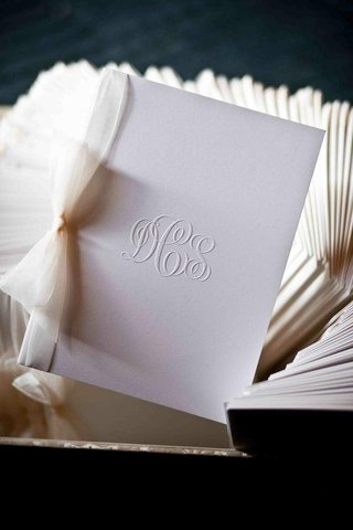 wedding-monogram-emboss-on-white-stationery-with-bow