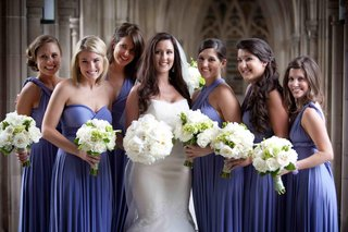 bride-with-bridesmaids-in-mismatched-purple-dresses