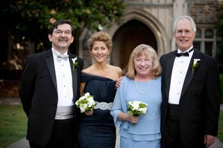 bride-and-grooms-parents-in-formal-wedding-attire