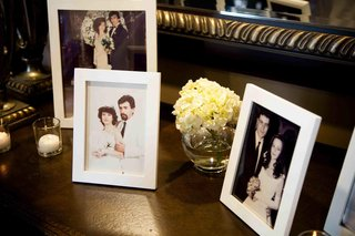 framed-old-wedding-portraits-on-table-at-ceremony