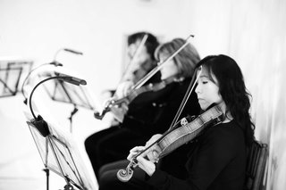 black-and-white-photo-of-women-playing-violin