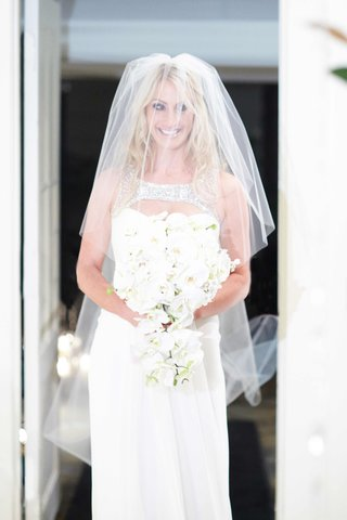 contemporary-wedding-dress-and-orchid-bouquet