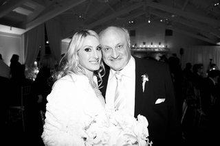 black-and-white-photo-of-bride-wearing-fur-jacket