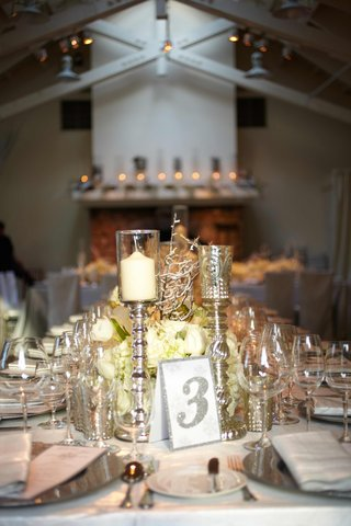silver-bordered-table-number-next-to-candlesticks
