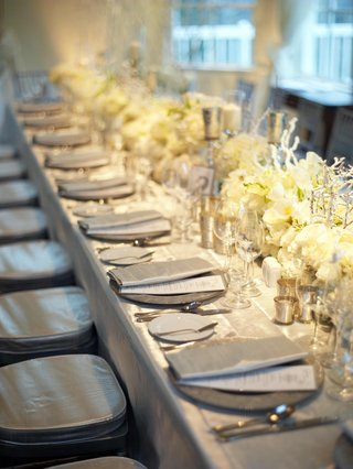 silver-reception-table-with-white-floral-arrangements